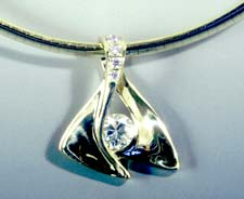 contemporary gold pendant with diamond